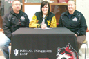 Caitlin Burroughs (middle) is joined by IU East coaches Charlie Brown (left) and Londa Brown)
